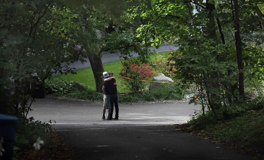 Nick Collins, right, embraces Minnetonka High School classmate Nathan Kahn during a visit Friday, Sept. 11, 2015, to the scene where five family members were found inside a home in Greenwood, Minn. Police pushed ahead Friday with their investigation into an apparent murder-suicide in the affluent Minneapolis suburb that left a family of five dead, while a high school offered counseling to classmates of the three children. (Jim Gehrz/Star Tribune via AP)  MANDATORY CREDIT; ST. PAUL PIONEER PRESS OUT; MAGAZINES OUT; TWIN CITIES LOCAL TELEVISION OUT Photo: Jim Gehrz, MBO / Star Tribune