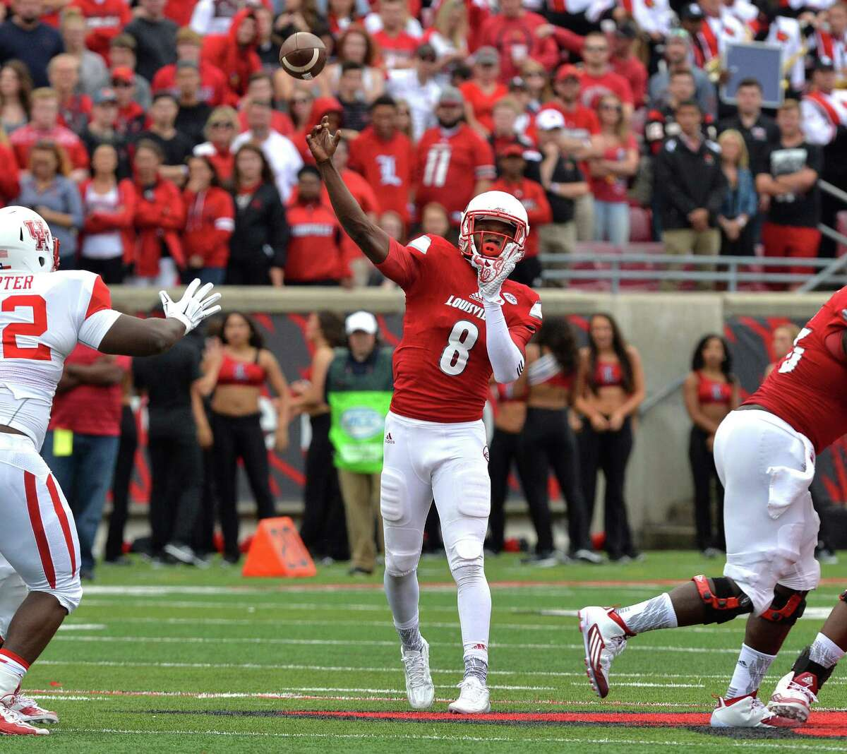 Louisville quarterback Lamar Jackson (8) attempts a pass during the second half of an NCAA college football game against Houston in Louisville, Ky. Saturday, Sept. 12, 2015. Houston defeated Louisville 34-31. (AP Photo/Timothy D. Easley)