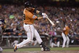 SAN FRANCISCO, CA - SEPTEMBER 11:  Buster Posey #28 of the San Francisco Giants hits an rbi single scoring Alejandro De Aza #45 against the San Diego Padres in the bottom of the third inning at AT&T Park on September 11, 2015 in San Francisco, California.  (Photo by Thearon W. Henderson/Getty Images)