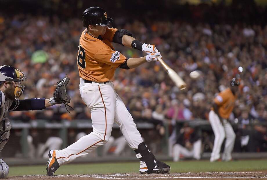 Giants catcher Buster Posey, the NL batting champion in 2012, is vying with Washington's Bryce Harper and Miami's Dee Gordon for the crown this year. Photo: Thearon W. Henderson, Getty Images