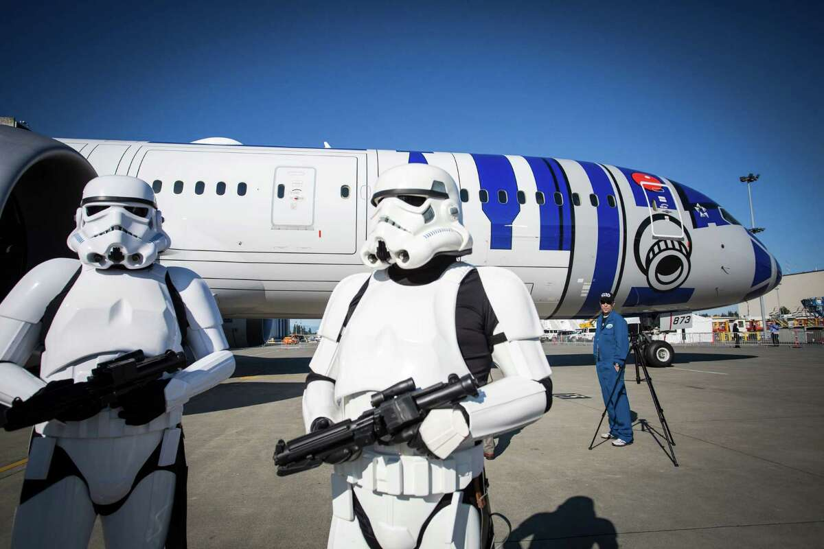 Two Stormtroopers stand guard in front of the R2-D2-themed Boeing 787-9 Dreamliner rolls out of a hangar at Boeing field in Everett on Saturday, September 12, 2015. Boeing and ANA revealed their collaboration with the Walt Disney Company (Japan) for the ANA Jet that will begin long range service in October.
