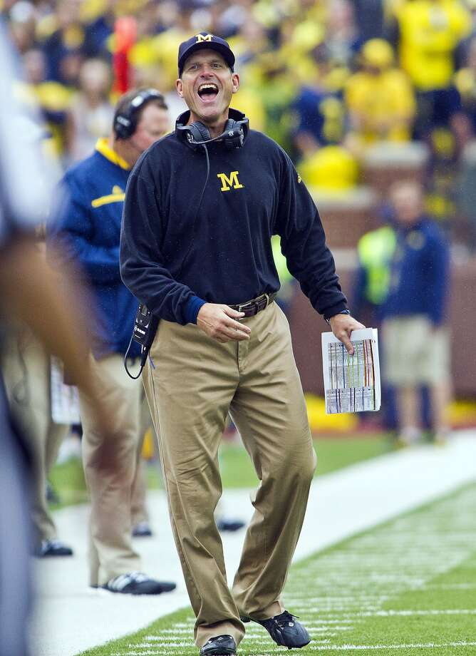 Michigan head coach Jim Harbaugh laughs and react to a referee on the sidelines in the fourth quarter of an NCAA college football game against Oregon State in Ann Arbor, Mich., Saturday, Sept. 12, 2015. Michigan won 35-7. (AP Photo/Tony Ding) Photo: Tony Ding, Associated Press