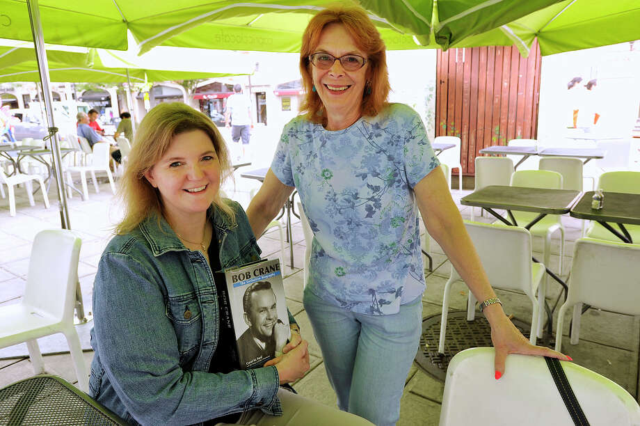 "Carol Ford, left, and co-author Dee Young pose with their book ""Bob Crane: The Definitive Biography"" outside Capriccio Cafe in Stamford. Photo: Jason Rearick / Hearst Connecticut Media / Stamford Advocate"