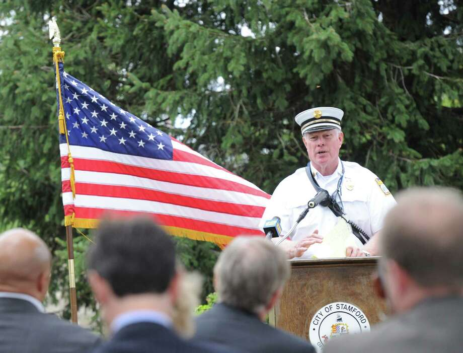 Stamford Deputy Fire Chief Tom Conroy spoke during the ceremony to honor Stamford families of 9/11 in the Jackie Robinson Park of Fame, Stamford, Conn., Friday, Sept. 11, 2015. Photo: Bob Luckey Jr. / Hearst Connecticut Media / Greenwich Time