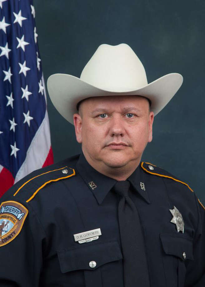 Harris County deputy Darren H. Goforth, 47, a 10-year department veteran was shot and killed at Chevron station on Friday night at Telge and West roads. Officials say the deputy was shot from behind and died at the scene. / handout