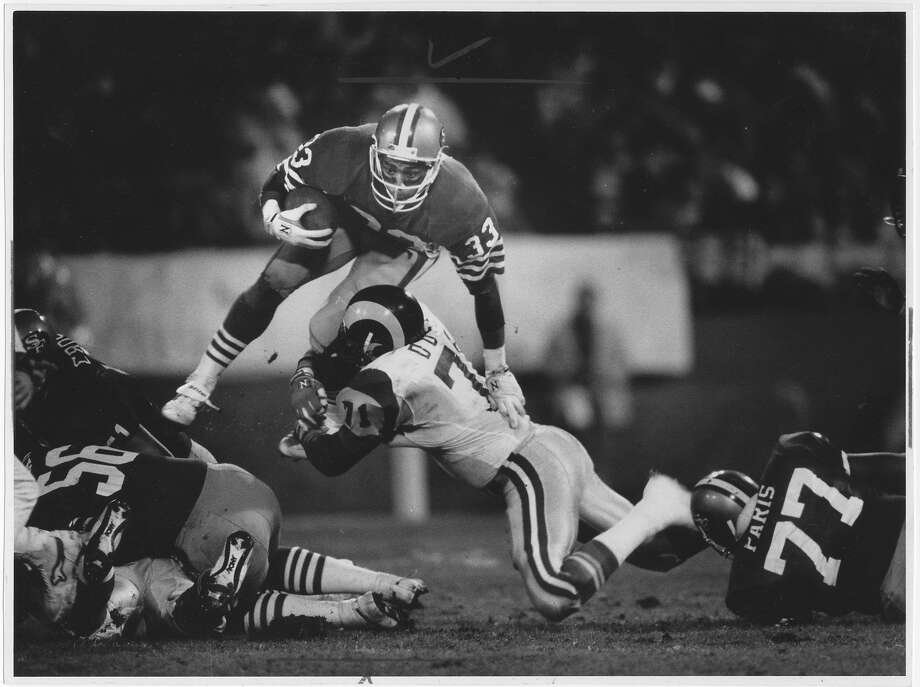 49ers running back Roger Craig, shown in a 1986 game against the Los Angeles Rams, had 8,189 yards rushing and 4,911 yards receiving in his career. Photo: Frederic Larson
