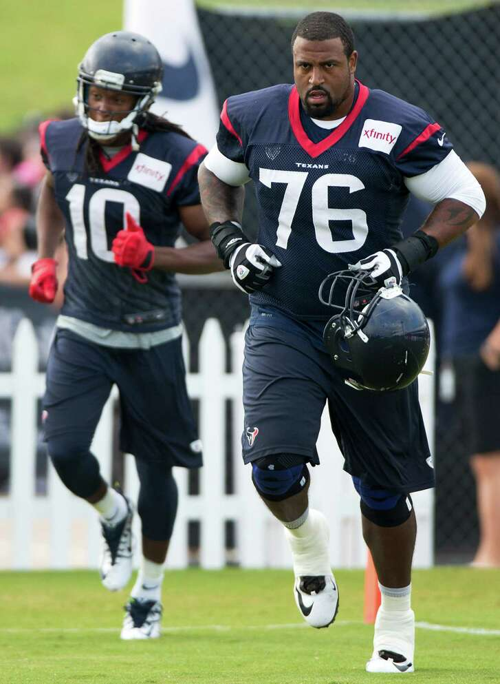 Houston Texans wide receiver DeAndre Hopkins (10) and tackle Duane Brown (76) jog onto the practice field during Texans training camp at the Methodist Training Center Sunday, Aug. 3, 2014, in Houston.  ( Brett Coomer / Houston Chronicle )