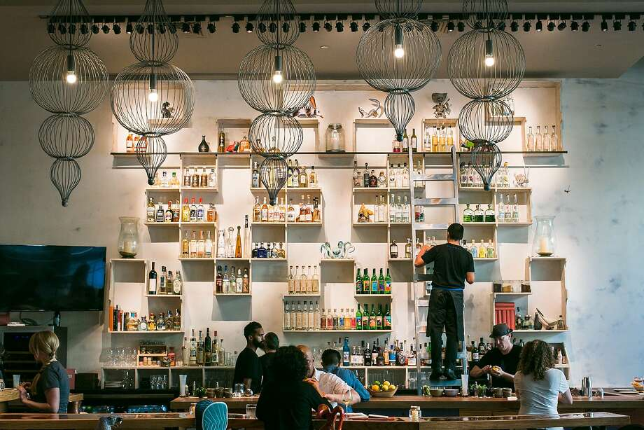 The bar at Calavera in Oakland displays many shelves full of different bottles of mezcal. Photo: Jen Fedrizzi, Special To The Chronicle