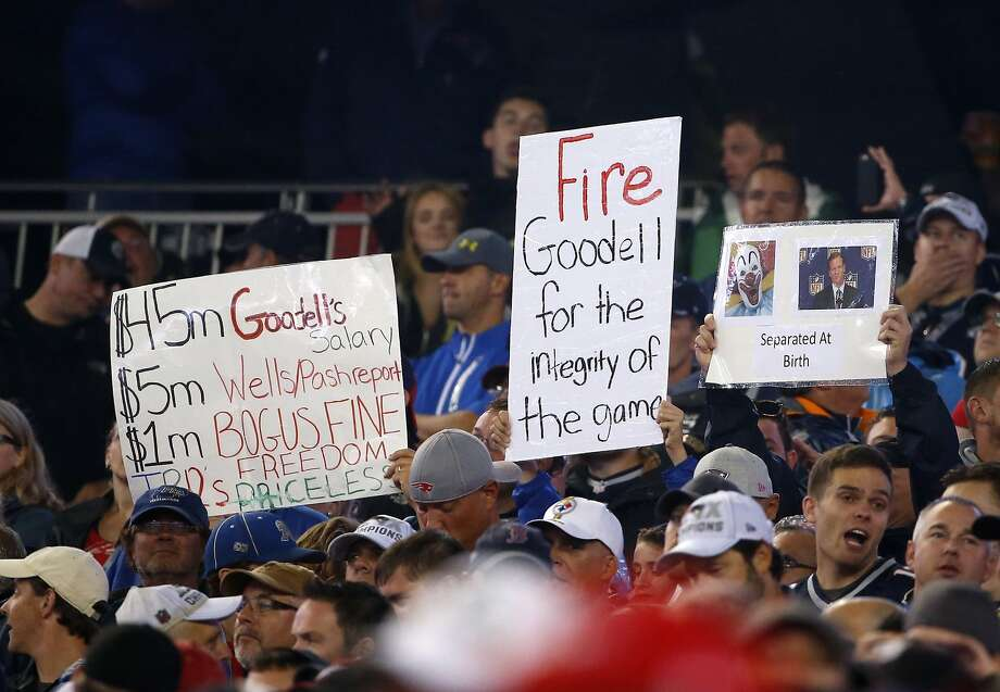 At the NFL season opener Thursday in Foxborough, Mass., New England Patriots fans hold signs criticizing NFL Commissioner Roger Goodell and his handling of the Deflategate case. Photo: Charles Krupa, Associated Press