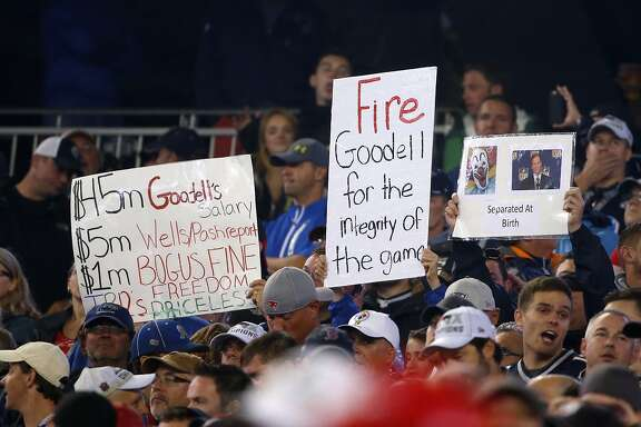 New England Patriots fans hold signed referring to NFL commissioner Roger Goodell during an NFL football game between the New England Patriots and the Pittsburgh Steelers, Thursday, Sept. 10, 2015, in Foxborough, Mass. (AP Photo/Charles Krupa)