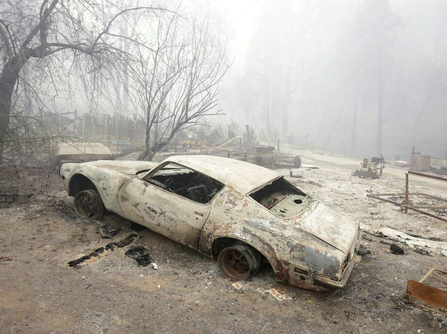 A car destroyed by the Butte Fire sits on tireless rims Saturday at a home in Mountain Ranch, Calif. Hundreds of people have had to flee their homes as the wildfire spreads across the drought-parched Sierra Nevada foothills, leaving behind their homes, livestock and other possessions. Photo: Rich Pedroncelli, STF / AP