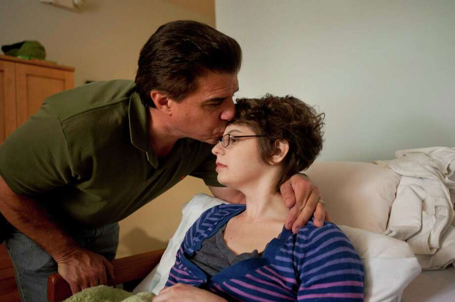 Kim Suozzi with her father Rick Suozzi at a hospice facility in Scottsdale, Ariz., on Jan. 6, 2013. Cancer claimed Suozzi at age 23, but she chose to have her brain preserved with the dream that neuroscience might one day revive her by preserving the unique pattern of connections in her brain. Photo: LAURA SEGALL, STR / NYTNS