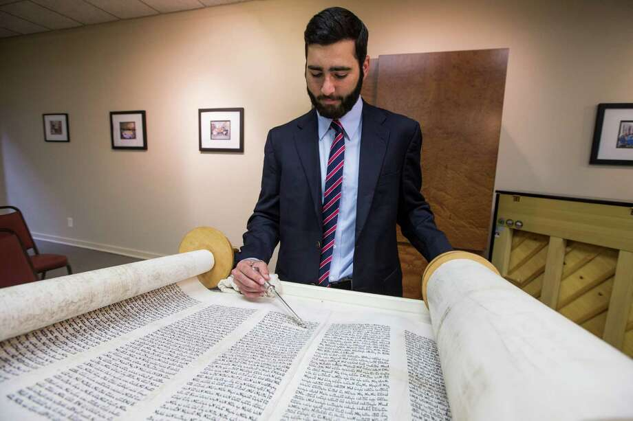 Jeremy Reiskind, a Rice University junior from St. Petersburg, Fla., reads a Torah on Friday at Houston Hillel.  Photo: Brett Coomer, Staff / © 2015 Houston Chronicle
