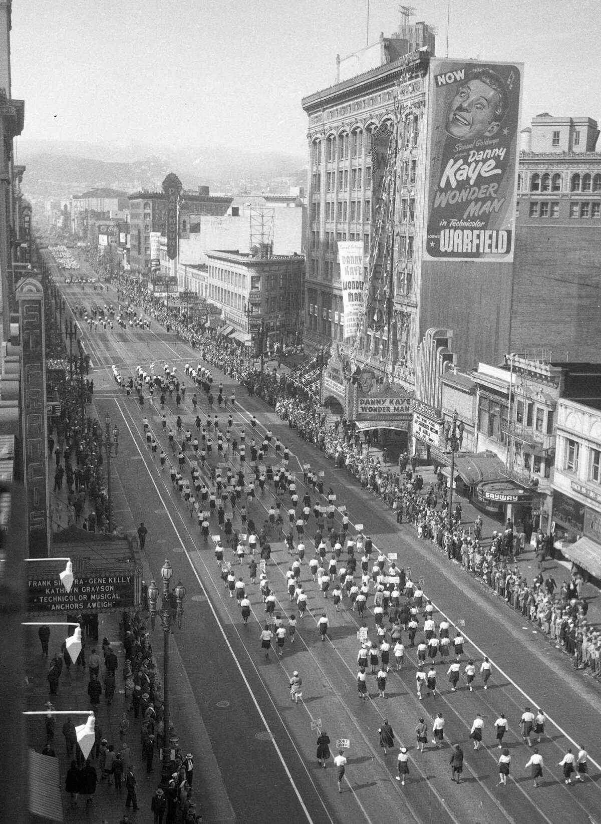 Parade goes by the the Warfield Theater, on Market Street in 1948.