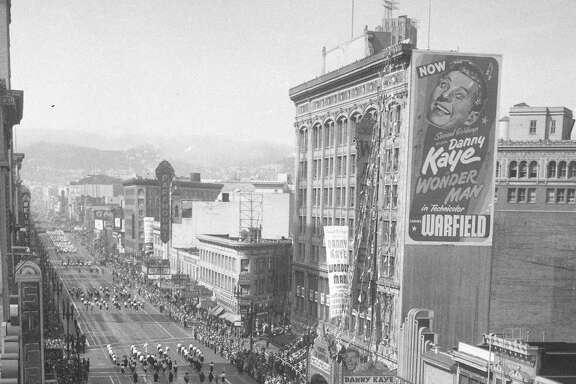 Parade goes by the the Warfield Theater, on Market Street photo shot 11/30/1948