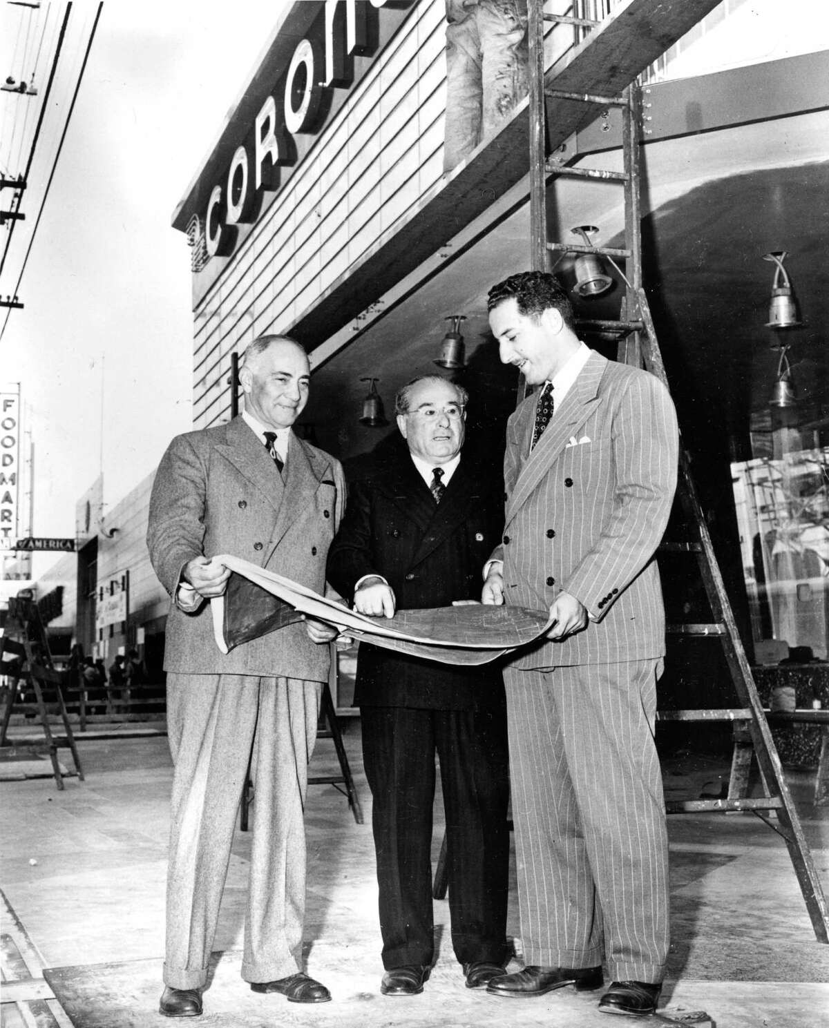 """San Francisco Theatres Inc. owners Samuel H. Levin, Michael Naify and Irvin M. """"Bud"""" Levin in front of the Coronet before it first opened in 1949. Photo courtesy of San Francisco Public Library History Center"""
