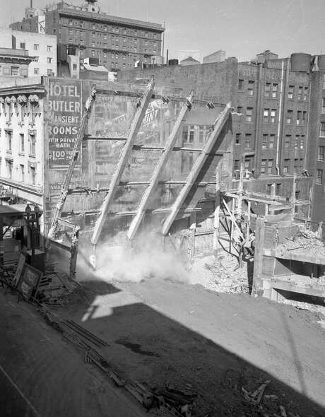 Demolishing the Downtown Theatre in February of 1953.  Photo: Joe Rosenthal / The Chronicle / ONLINE_YES