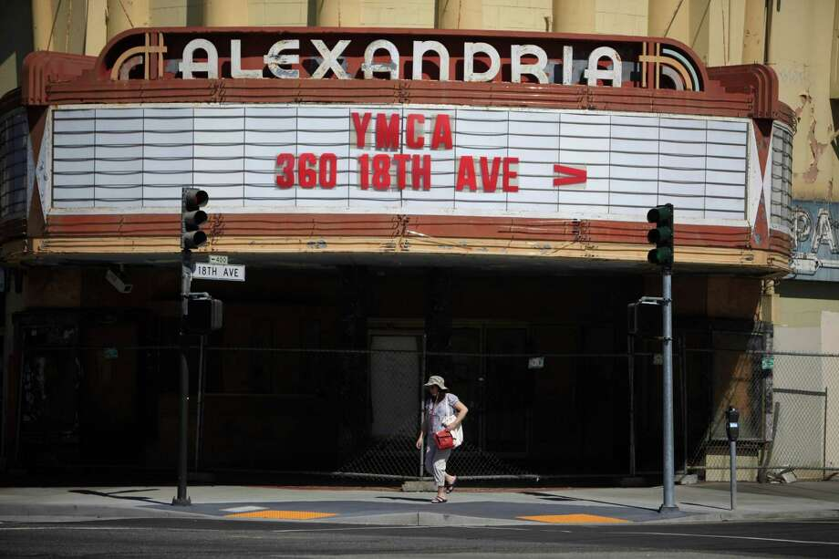 A pedestrian walks past the closed Alexandria Theater at the corner of Geary Boulevard and 18th Avenue on Wednesday, May 14, 2014 in San Francisco, Calif. Photo: Lea Suzuki / The Chronicle / ONLINE_YES