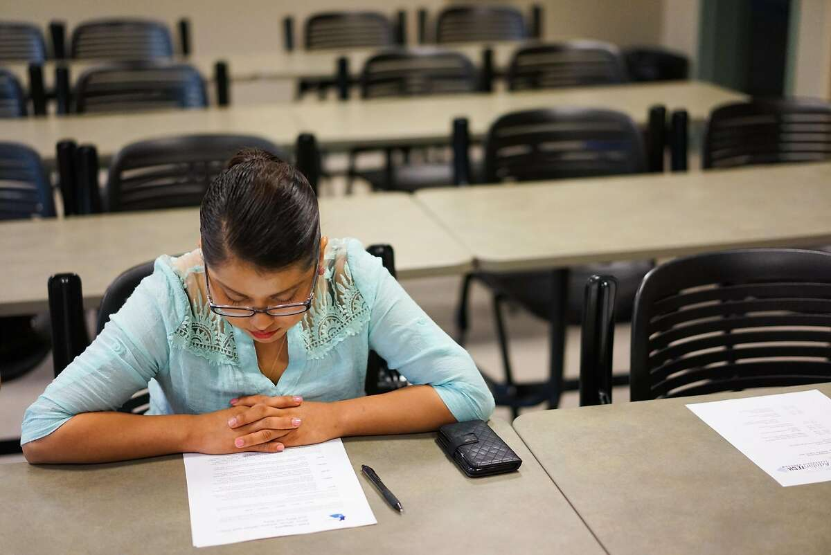 Lidia Bautista works on an assignment during an AdelanTECH class at the Hartnell Community College Alisal Campus in Salinas, Calif. on Saturday, Sept. 12, 2015. The AdelanTECH Leader Program teaches leadership and coding skills to farmworkers and their children.