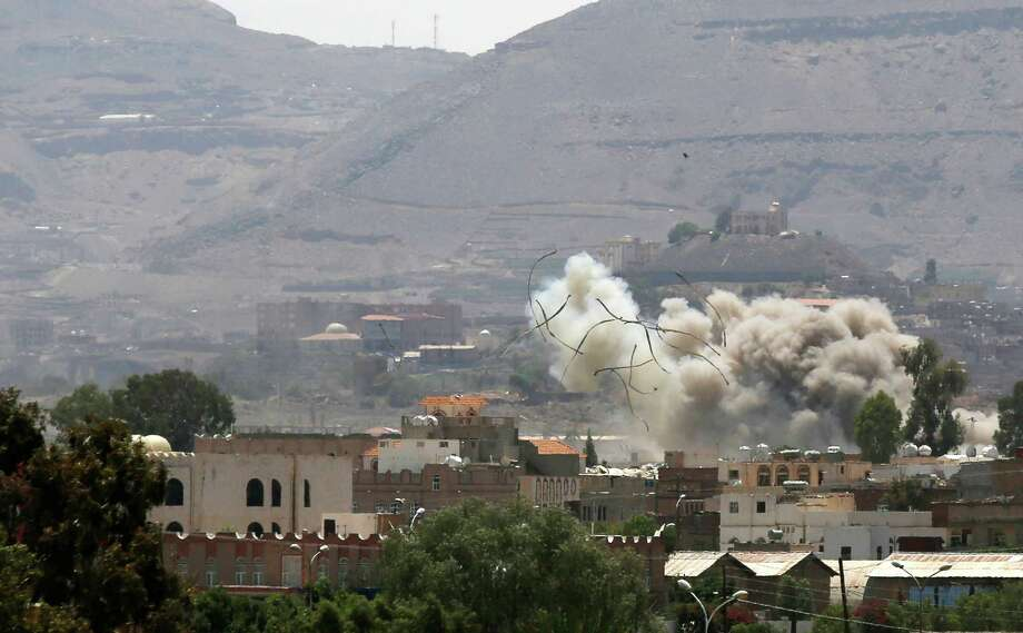Debris and smoke rise after a Saudi-led airstrike hits an army base in Sanaa, Yemen, Saturday, Sept. 12, 2015. Yemen has been torn by a ferocious war pitting rebels, known as Houthis, and forces fighting for former President Ali Abdullah Saleh against fighters loyal to exiled President Abed Rabbo Mansour Hadi, as well as southern separatists, local militias and Sunni extremists. (AP Photo/Hani Mohammed) ORG XMIT: AHM103 Photo: Hani Mohammed / AP