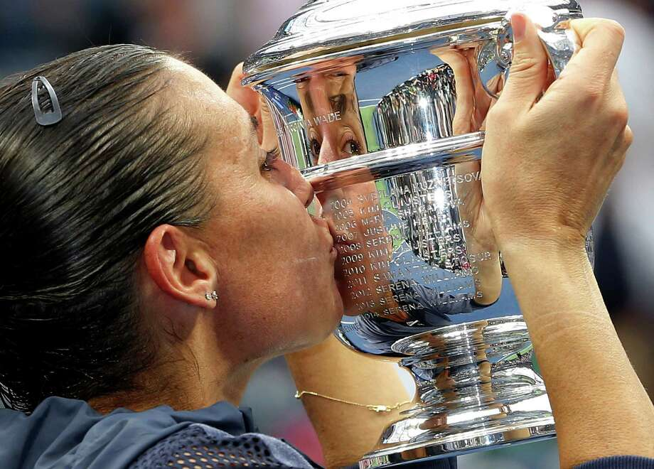 Flavia Pennetta of Italy won her first Grand Slam trophy at age 33 - then abruptly retired. Photo: Julio Cortez, STF / AP
