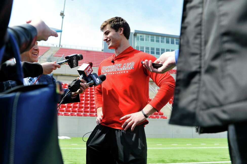 RPI football kicker, Andrew Franks, center, talks to members of the media after he took part in a tryout in front of three NFL scouts on Monday, April 6, 2015, at RPI in Troy, N.Y. (Paul Buckowski / Times Union)