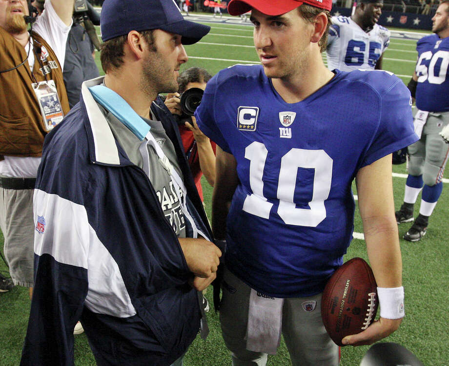 FOR SPORTS - Dallas Cowboys' Tony Romo talks with New York Giants' Eli Manning after the game Monday Oct. 25, 2010 at Cowboys Stadium in Arlington, Tx. The Giants won 41-35. (PHOTO BY EDWARD A. ORNELAS/eaornelas@express-news.net) Photo: EDWARD A. ORNELAS, Eaornelas@express-news.net / SAN ANTONIO EXPRESS-NEWS / eaornelas@express-news.net