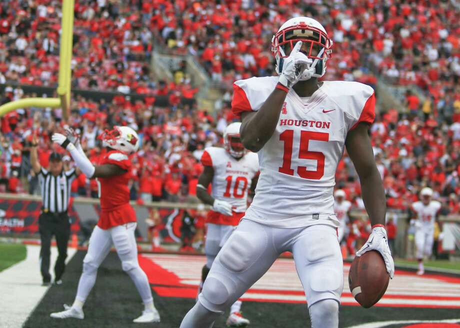 Houston's Linell Bonner hopes to shush the crowd Saturday after his fourth-quarter touchdown catch at Louisville. Photo: Matt Stone / staff/The Courier-Journal