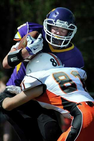 Salem's Seth Turcie, left, carries the ball as Cambridge's Max Hoffer defends during their football game on Saturday, Sept. 5, 2015, at Salem High in Salem, N.Y. (Cindy Schultz / Times Union) Photo: Cindy Schultz / 00033242A