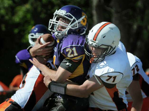 Salem's Ryan Slater, center, is sandwiched by Cambridge defenders Max Hoffer, left, and Lucas Winchester during their football game on Saturday, Sept. 5, 2015, at Salem High in Salem, N.Y. (Cindy Schultz / Times Union) Photo: Cindy Schultz / 00033242A