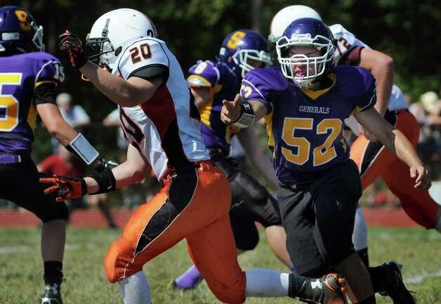 Salem's defenseman Houston Wood, right, runs a play during their football game against Cambridge on Saturday, Sept. 5, 2015, at Salem High in Salem, N.Y. (Cindy Schultz / Times Union) Photo: Cindy Schultz / 00033242A