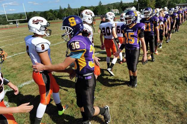 Salem's team, right, congratulates the Cambridge team following their football game on Saturday, Sept. 5, 2015, at Salem High in Salem, N.Y. (Cindy Schultz / Times Union) Photo: Cindy Schultz / 00033242A