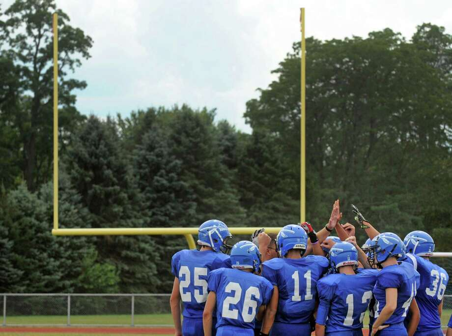 The Hoosic Valley High School football team gets ready to take the field to begin their game against Corinth on Saturday Sept. 12, 2015 in Schaghticoke, N.Y.  (Michael P. Farrell/Times Union) Photo: Michael P. Farrell / 00033304B