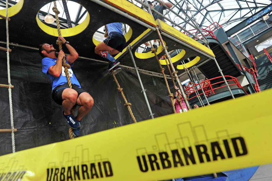 Runner athletes compete in an obstacle course run the Urban RAID Albany that began and ended at the Times Union Center on Saturday Sept. 12, 2015 in Albany, N.Y.  (Michael P. Farrell/Times Union) Photo: Michael P. Farrell / 00033171A