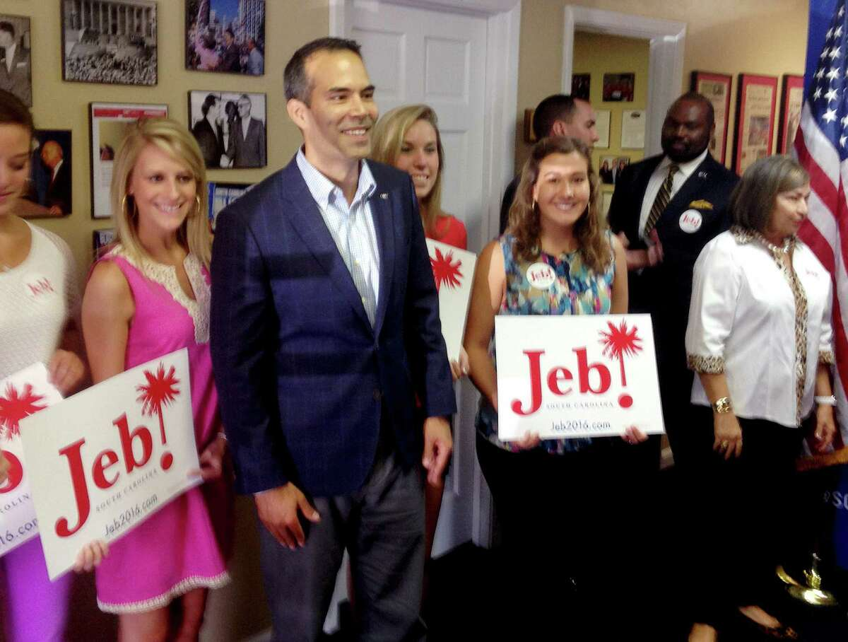 Texas Land Commissioner George P. Bush, third from the left, poses with supporters after turning in paperwork with the South Carolina Republican Party that will formally put his father Jeb's name on the state's 2016 presidential ballot on Friday, July 31, 2015, in Columbia, South Carolina. Bush has been helping members of his famous family get elected since age 3 but has never played a larger role as a political surrogate than this cycle, as he tries to help his dad follow his grandfather, George H.W. Bush, and his uncle, George W. Bush, to the White House. (AP Photo/Will Weissert)
