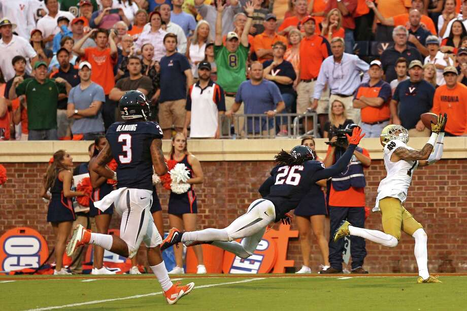 CHARLOTTESVILLE, VA - SEPTEMBER 12: Wide receiver William Fuller #7 of the Notre Dame Fighting Irish catches the game-winning touchdown pass in front of cornerback Maurice Canady #26 of the Virginia Cavaliers in the fourth quarter at Scott Stadium on September 12, 2015 in Charlottesville, Virginia. The Notre Dame Fighting Irish won, 34-27. (Photo by Patrick Smith/Getty Images) ORG XMIT: 567728715 Photo: Patrick Smith / 2015 Getty Images