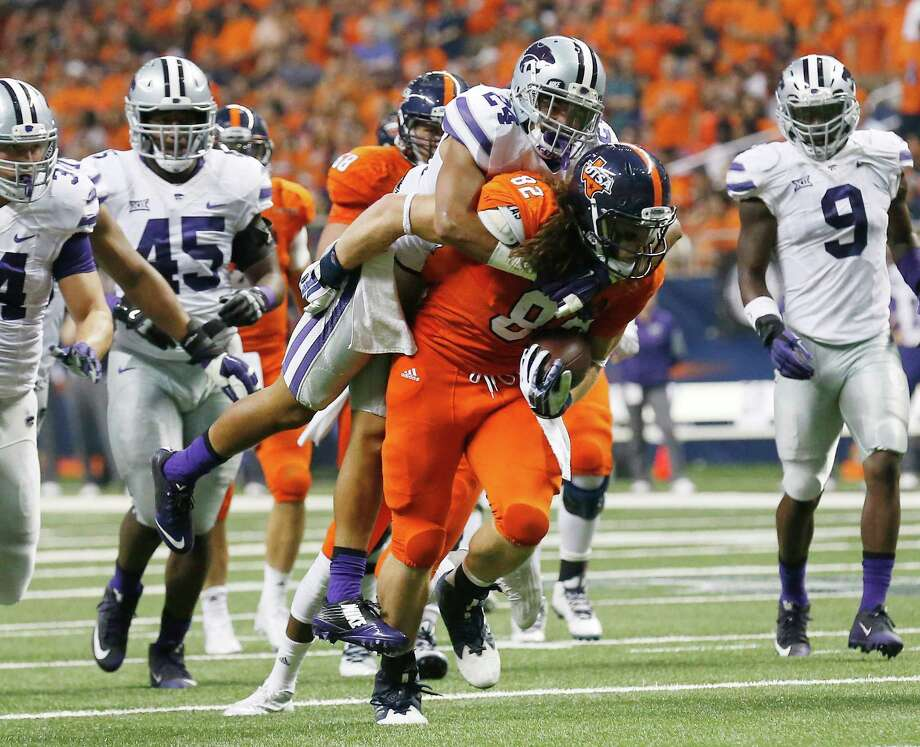 UTSA's David Morgan II (82) hauls Kansas State Wildcats's Nate Jackson (24) on his back after a catch in the first half at the Alamodome on Saturday, Sept. 12, 2015. (Kin Man Hui/San Antonio Express-News) Photo: Kin Man Hui, Staff / San Antonio Express-News / ©2015 San Antonio Express-News
