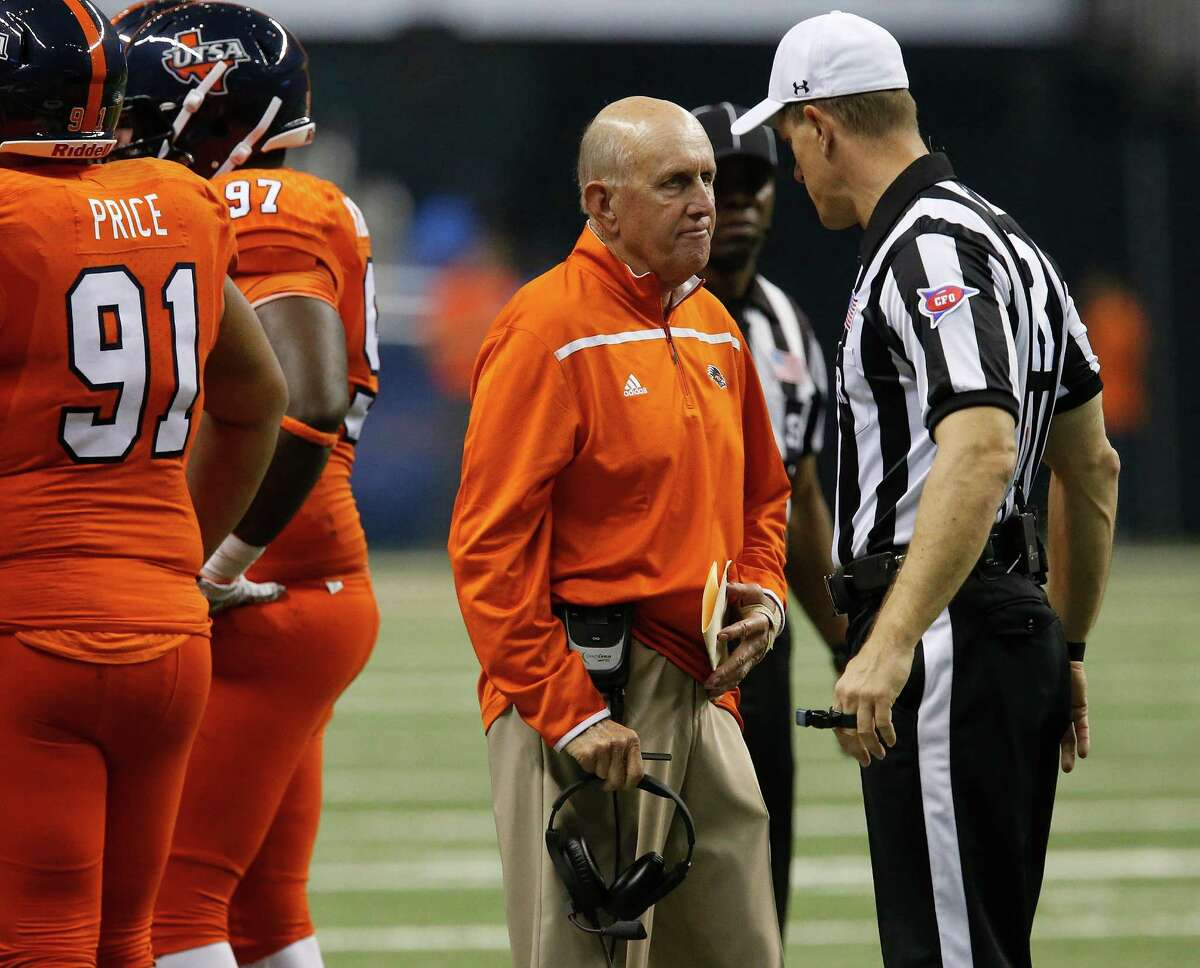UTSA head coach Larry Coker chats with an official during the game against Kansas State at the Alamodome on Sept. 12, 2015.