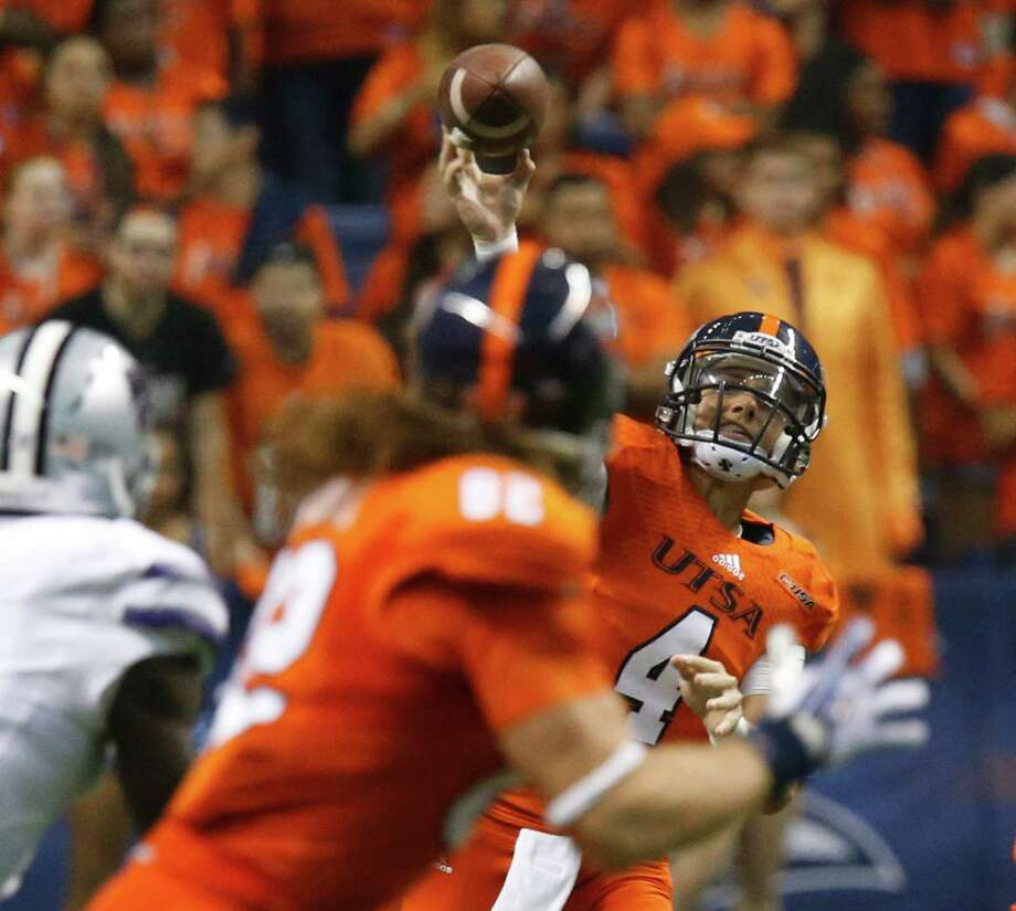 UTSA's Blake Bogenschutz attempts a pass against Kansas State in the first half at the Alamodome on Sept. 12, 2015. Photo: Kin Man Hui /San Antonio Express-News / ©2015 San Antonio Express-News