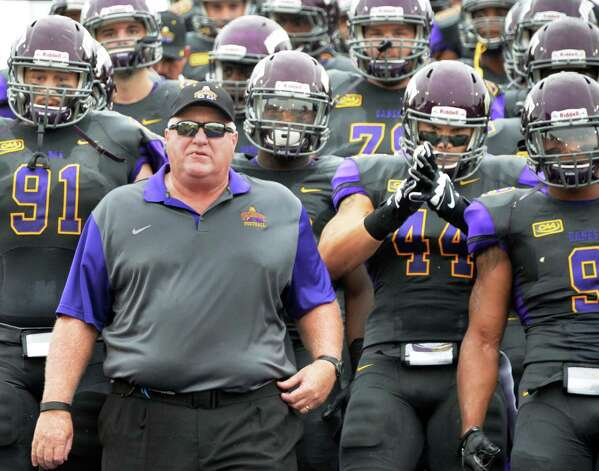 UAlbany head coach Greg Gattuso leads his players on to the field for Saturday's game against Rhode Island in their home opener at Bob Ford Field Sept. 12, 2015 in Albany,NY.  (John Carl D'Annibale / Times Union) Photo: John Carl D'Annibale / 00033334A