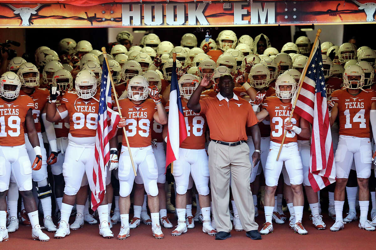 Members of the Texas Longhorns football team prepare to take the field before the game with Rice Saturday Sept. 12, 2015 at Texas Memorial Stadium in Austin, Tx.