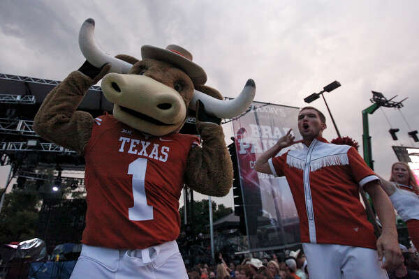 "The University of Texas Longhorns mascot Hook 'Em and cheerleaders perform prior to the start of the ""Country Nation College Tour"" free concert with Brad Paisley and Pat Green, presented by Zaxby's, in a parking lot at UFCU Disch-Falk Field Thursday, Sept. 10, 2015 in Austin, Tx."
