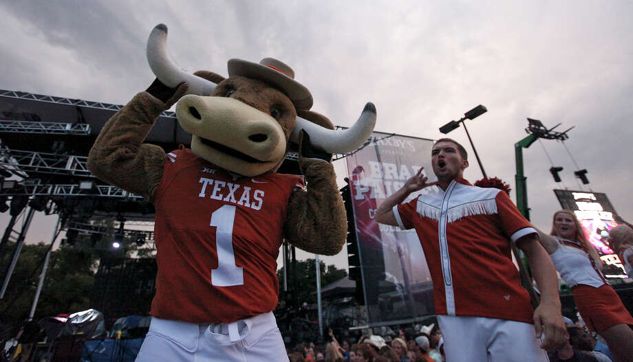 The University of Texas Longhorns mascot Hook 'Em and cheerleaders perform Thursday before a concert at the UFCU Disch-Falk Field. The Longhorns ranked No. 1 in collegiate merchandise sales for nine consecutive years. Photo: Edward A. Ornelas, Staff / © 2015 San Antonio Express-News