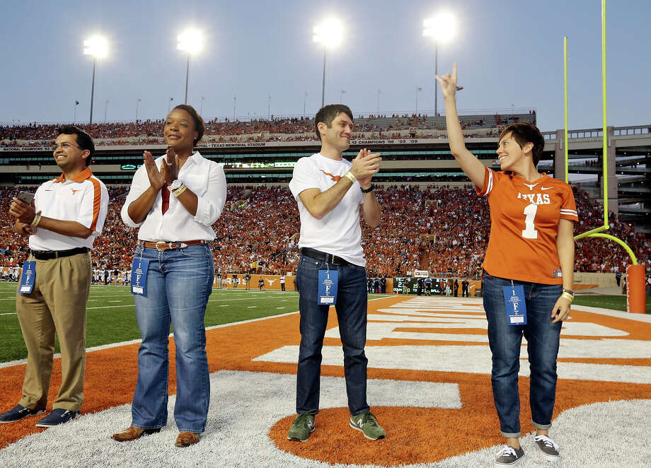 Outstanding Young Texas Ex Award winners Muhammad Mustafa Hussain (from left), Kedra Ishop, Jake Silverstein, and Jamie Stockwell are honored on the field during the Texas and Rice football game held Saturday Sept. 12, 2015 at Texas Memorial Stadium in Austin, Tx. Photo: Edward A. Ornelas, Staff / San Antonio Express-News / © 2015 San Antonio Express-News