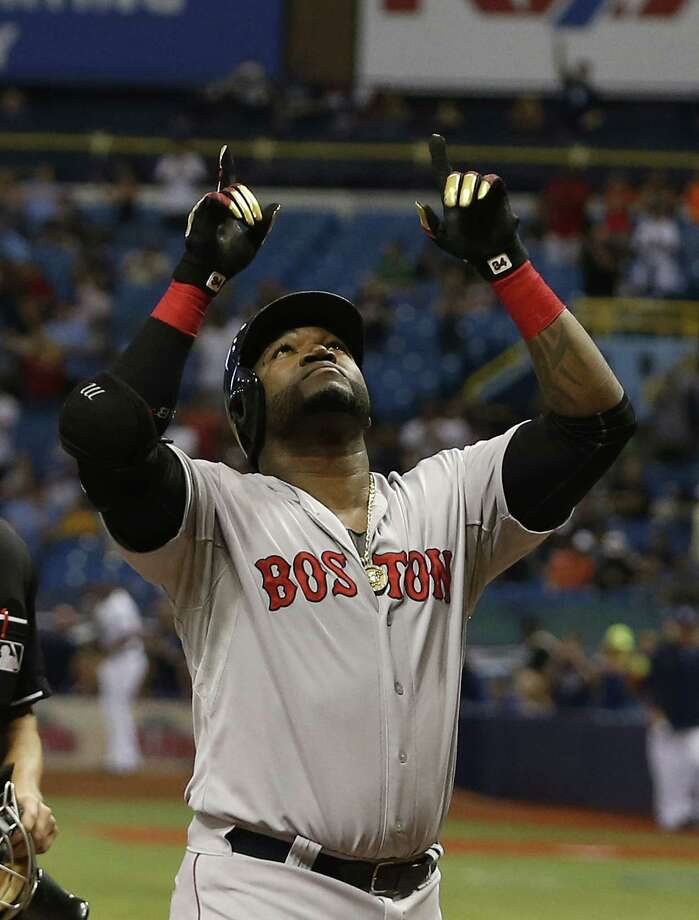 ST. PETERSBURG, FL - SEPTEMBER 12:  David Ortiz #34 of the Boston Red Sox celebrates after hitting his 500th career MLB home run off of pitcher Matt Moore #55 of the Tampa Bay Rays during the fifth inning of a game on September 12, 2015 at Tropicana Field in St. Petersburg, Florida.  (Photo by Brian Blanco/Getty Images) ORG XMIT: 538594747 Photo: Brian Blanco / 2015 Getty Images