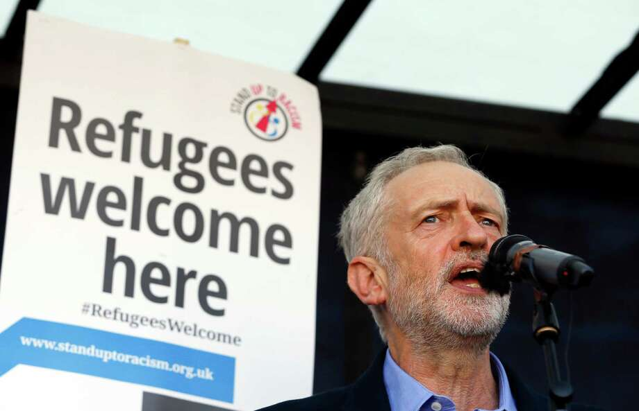 Jeremy Corbyn, the newly elected leader of Britain's opposition Labor Party, gives a speech at a Solidarity with Refugees march Saturday in London. He has called for nationalizing energy and rail companies, among other issues. Whether he can unify the Labor Party is questionable. Photo: Kirsty Wigglesworth, STF / AP