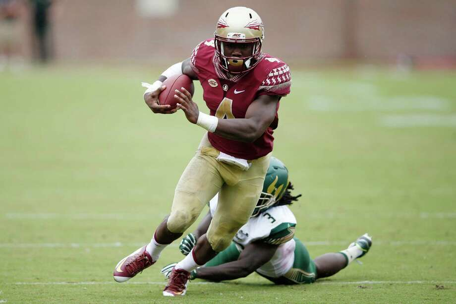 TALLAHASSEE, FL - SEPTEMBER 12: Dalvin Cook #4 of the Florida State Seminoles runs for a 24-yard touchdown against the South Florida Bulls in the third quarter at Doak Campbell Stadium on September 12, 2015 in Tallahassee, Florida. Florida State defeated South Florida 34-14. (Photo by Joe Robbins/Getty Images) Photo: Joe Robbins, Stringer / 2015 Getty Images