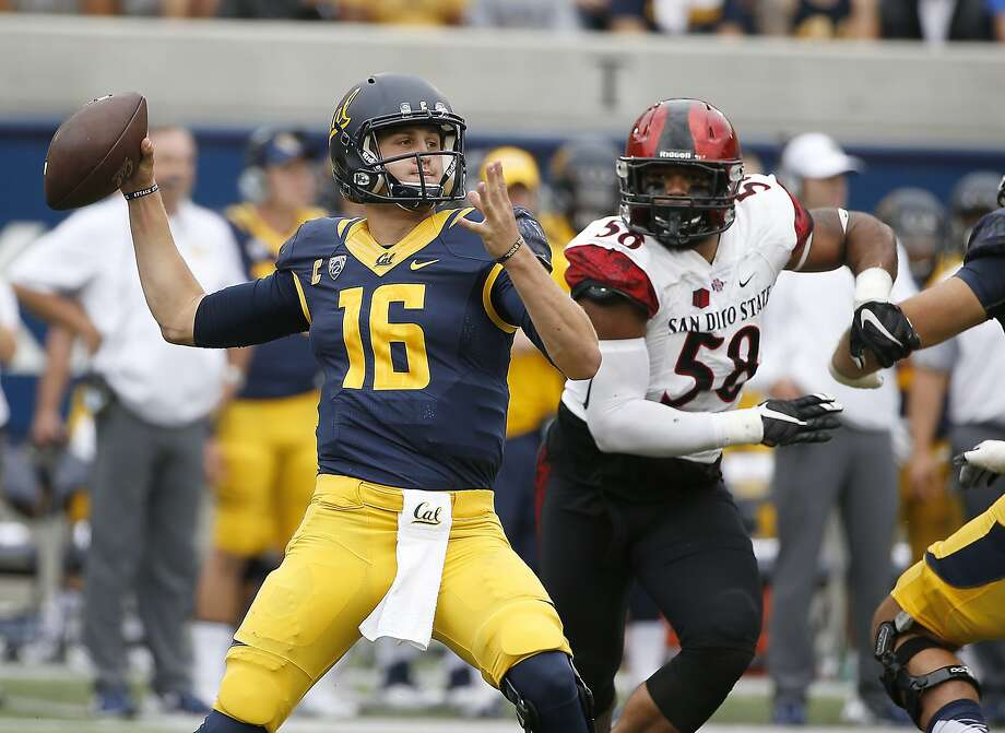 Cal quarterback Jared Goff passes under pressure from San Diego State defender Alex Barrett during the Bears' 35-7 victory. Goff threw for 321 yards and three TDs in the game. Photo: Tony Avelar, Associated Press