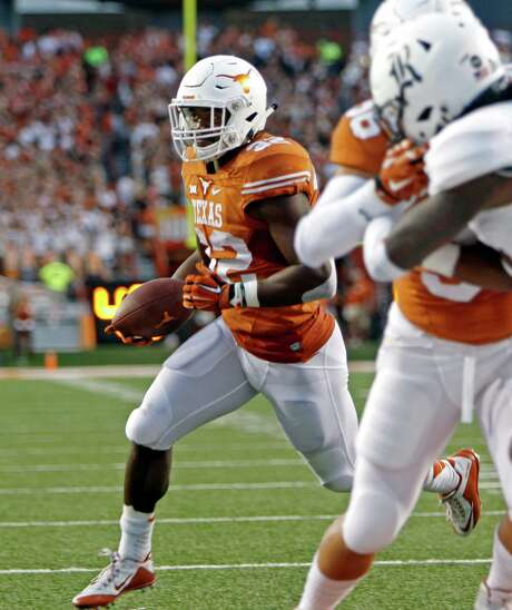 Texas running back Johnathan Gray (32) runs for a touchdown during the first half of an NCAA college football game against Rice, Saturday, Sept. 12, 2015, in Austin, Texas. (AP Photo/Michael Thomas) Photo: Michael Thomas, FRE / FR65778 AP