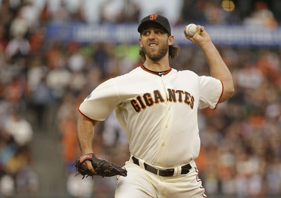 San Francisco Giants starting pitcher Madison Bumgarner throws against the San Diego Padres during the second inning of a baseball game Saturday, Sept. 12, 2015, in San Francisco. (AP Photo/Eric Risberg) Photo: Eric Risberg, Associated Press
